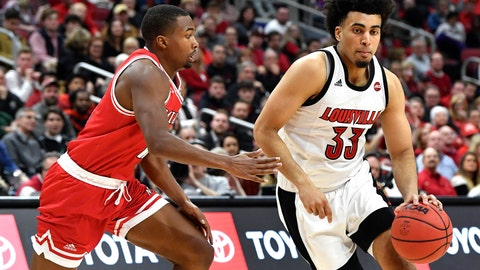 <p>               Louisville forward Jordan Nwora (33) tries to get around Miami (Ohio) guard Myja White (11) during the second half of an NCAA college basketball game in Louisville, Ky., Wednesday, Dec. 18, 2019. Louisville won 70-46. (AP Photo/Timothy D. Easley)             </p>