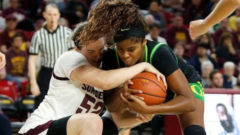 <p>               Arizona State center Jamie Ruden (52) and Oregon forward Ruthy Hebard compete for possession of the ball during the first half of an NCAA college basketball game Friday, Jan. 10, 2020, in Tempe, Ariz. (AP Photo/Ralph Freso)             </p>