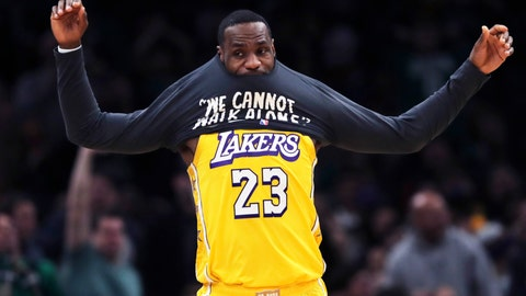 <p>               Los Angeles Lakers forward LeBron James puts on a warm-up shirt as he goes to the bench during the first half of an NBA basketball game against the Boston Celtics in Boston, Monday, Jan. 20, 2020. (AP Photo/Charles Krupa)             </p>