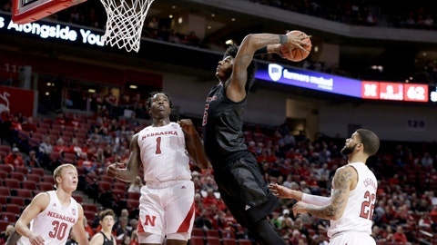 <p>               Nebraska's Charlie Easley (30), Kevin Cross (1) and Haanif Cheatham (22) watch as Rutgers' Myles Johnson (15)] goes up for a dunk during the second half of an NCAA college basketball game in Lincoln, Neb., Friday, Jan. 3, 2020. Rutgers won 79-62. (AP Photo/Nati Harnik)             </p>