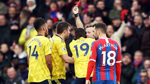 <p>               Referee Paul Tierney shows Pierre-Emerick Aubameyang, left, a red card following a VAR review , during the English Premier League soccer match between Crystal Palace and Arsenal, at Selhurst Park, in London, Saturday,  Jan. 11, 2020. (Tess Derry/PA via AP)             </p>
