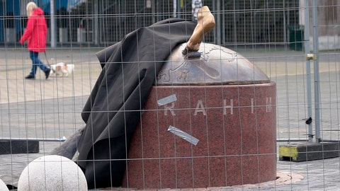 <p>               A black cloth used to hide the vandalized statue of Zlatan Ibrahimovic uncovers a bronze foot from the block of stone, outside the stadium of Malmo's soccer team in Malmo, Sweden, Thursday, Jan. 16, 2020. Two feet are all that remains of the local hero and one of Sweden's greatest ever sports stars. After a series of attacks by vandals, the statue is holed up in a secret location undergoing repairs. (AP Photo/David Keyton)             </p>