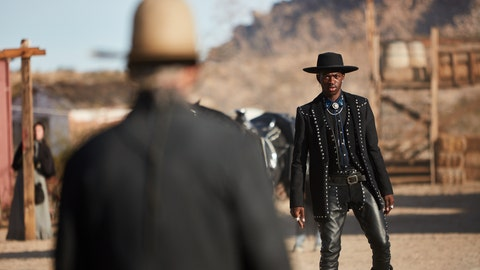 """<p>               This undated photo provided by Doritos shows Lil Nas X, right, and Sam Elliott in a scene from the company's 2020 Super Bowl NFL football spot. The snack chip is betting people will connect with """"Old Town Road,"""" the smash hit of the summer by Lil Nas X. (Doritos via AP)             </p>"""
