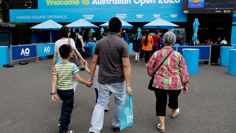<p>               Spectators arrive at Melbourne Park as qualifying matches for the Australian Open tennis championship continue in Melbourne, Australia, Friday, Jan. 17, 2020. The season's opening Grand Slam event begins here Monday Jan. 20. (AP Photo/Mark Baker)             </p>