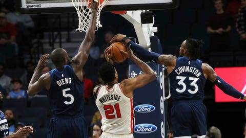 <p>               Minnesota Timberwolves' Robert Covington, right, blocks a shot-attempt by Portland Trail Blazers' Hassan Whiteside, center as Timberwolves' Gorgui Dieng, of Senegal, also defends in the first half of an NBA basketball game Thursday, Jan. 9, 2020, in Minneapolis. (AP Photo/Jim Mone)             </p>