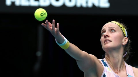 <p>               Petra Kvitova of the Czech Republic serves to Spain's Paula Badosa during their second round singles match at the Australian Open tennis championship in Melbourne, Australia, Wednesday, Jan. 22, 2020. (AP Photo/Dita Alangkara)             </p>