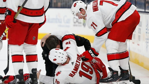 <p>               Carolina Hurricanes' head athletic trainer Doug Bennett attends to Dougie Hamilton after Hamilton was injured in the second period of an NHL hockey game against the Columbus Blue Jackets, Thursday, Jan. 16, 2020, in Columbus, Ohio. (AP Photo/Jay LaPrete)             </p>