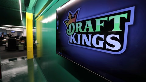 """<p>               FILE - In this May 2, 2019, file photo, the DraftKings logo is displayed at the sports betting company headquarters in Boston. DraftKings is reviewing a former """"Bachelor"""" contestant's $1 million win in an online fantasy football contest after she and her husband were accused of cheating. Jade Roper-Tolbert, who appeared in """"The Bachelor"""" and """"Bachelor in Paradise"""" television series in 2015, beat more than 100,000 entries to take the top prize in DraftKings' """"Millionaire Maker"""" contest, which involved picking a lineup of players from the NFL's four wild-card games during the weekend of Jan. 4-5, 2020. (AP Photo/Charles Krupa, File)             </p>"""