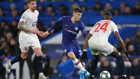 <p>               Chelsea's Christian Pulisic fights for the ball against Lille's Boubakary Soumare during the Champions League Group H soccer match between Chelsea and Lille at Stamford Bridge stadium in London Tuesday, Dec. 10, 2019. (AP Photo/Kirsty Wigglesworth)             </p>