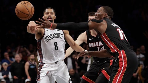 <p>               Brooklyn Nets' Spencer Dinwiddie (8) passes the ball away from Miami Heat's Bam Adebayo (13) during the second half of an NBA basketball game Friday, Jan. 10, 2020, in New York. The Nets won 117-113. (AP Photo/Frank Franklin II)             </p>