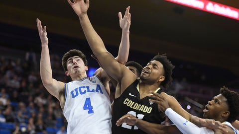 <p>               Colorado's forward Evan Battey, center, and UCLA's guard Jaime Jaquez Jr. (4) and guard David Singleton compete for a rebound during the first half of an NCAA college basketball game Thursday, Jan. 30, 2020, in Los Angeles. (AP Photo/Michael Owen Baker)             </p>