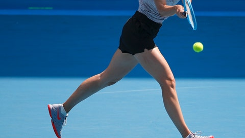 <p>               Russia's Maria Sharapova hits a backhand return during a practice session ahead of the Australian Open tennis championship in Melbourne, Australia, Sunday, Jan. 19, 2020. (AP Photo/Andy Wong)             </p>