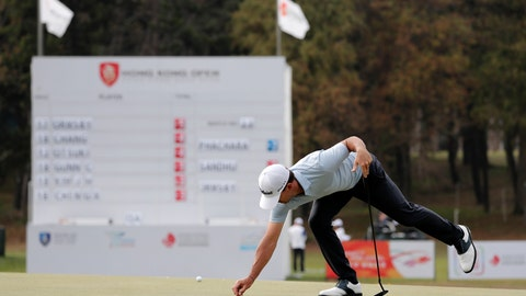 <p>               Wade Ormsby of Australia clears for his putt on the 18th hole during the Hong Kong Open golf tournament at Fanling Golf Club in Hong Kong, Thursday, Jan. 9, 2020. (AP Photo/Andy Wong)             </p>