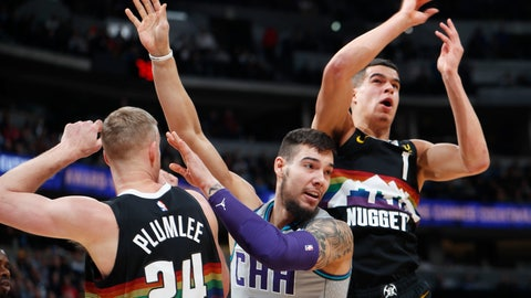 <p>               From left, Denver Nuggets forward Mason Plumlee, Charlotte Hornets center Willy Hernangomez and Nuggets forward Michael Porter Jr. look for a rebound ruing the first half of an NBA basketball game Wednesday, Jan. 15, 2020, in Denver. (AP Photo/David Zalubowski)             </p>