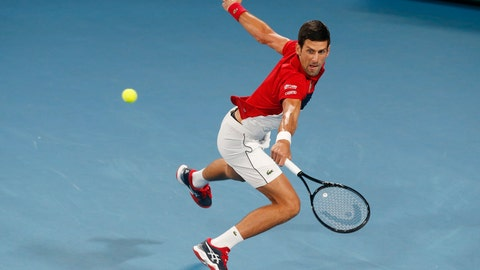 <p>               Novak Djovovic of Serbia plays a shot against Rafael Nadal of Spain during their ATP Cup tennis match in Sydney, Sunday, Jan. 12, 2020. (AP Photo/Steve Christo)             </p>