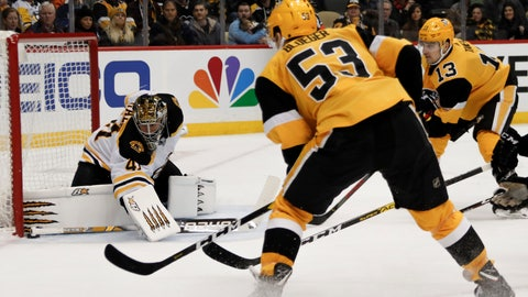 <p>               Boston Bruins goaltender Jaroslav Halak (41) keeps the puck out of the net as Pittsburgh Penguins' Teddy Blueger (53) and Brandon Tanev (13) look for a rebound during the second period of an NHL hockey game, Sunday, Jan. 19, 2020, in Pittsburgh. (AP Photo/Keith Srakocic)             </p>