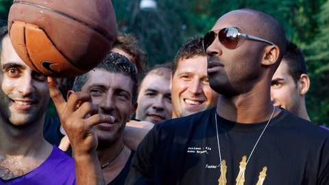 """<p>               FILE - In this Sept. 28, 2011, file photo, U.S. basketball star Kobe Bryant plays with a ball during a sponsor's appearance in Milan, Italy. In Europe where Bryant grew up, the retired NBA star is being remembered for his """"Italian qualities."""" Italian basketball federation president Giovanni Petrucci tells The Associated Press that Bryant is """"particularly important to us because he knew Italy so well, having lived in several cities here.  He had a lot of Italian qualities."""" (AP Photo/Luca Bruno, File)             </p>"""