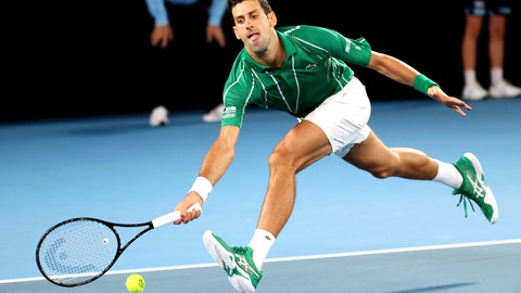 <p>               Serbia's Novak Djokovic reaches for a forehand return to Germany's Jan-Lennard Struff during their first round singles match the Australian Open tennis championship in Melbourne, Australia, Monday, Jan. 20, 2020. (AP Photo/Lee Jin-man)             </p>
