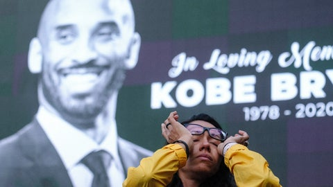 <p>               Nicole Mascarenhas, wipes her eyes in front of a screen with the late Kobe Bryant at a memorial for Kobe Bryant near Staples Center Monday, Jan. 27, 2020, in Los Angeles. Bryant, the 18-time NBA All-Star who won five championships and became one of the greatest basketball players of his generation during a 20-year career with the Los Angeles Lakers, died in a helicopter crash Sunday. (AP Photo/Ringo H.W. Chiu)             </p>