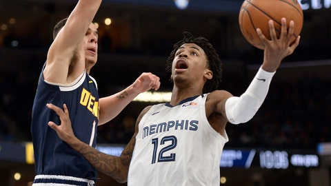<p>               Memphis Grizzlies guard Ja Morant (12) shoots against Denver Nuggets forward Michael Porter Jr. (1) in the second half of an NBA basketball game Tuesday, Jan. 28, 2020, in Memphis, Tenn. (AP Photo/Brandon Dill)             </p>