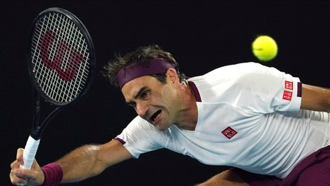 <p>               Switzerland's Roger Federer makes a forehand return to Hungary's Marton Fucsovics during their fourth round singles match at the Australian Open tennis championship in Melbourne, Australia, Sunday, Jan. 26, 2020. (AP Photo/Lee Jin-man)             </p>