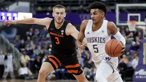 <p>               Washington guard Jamal Bey (5) drives around Oregon State forward Tres Tinkle (3) during the first half of an NCAA college basketball game Thursday, Jan. 16, 2020, in Seattle. (AP Photo/Ted S. Warren)             </p>