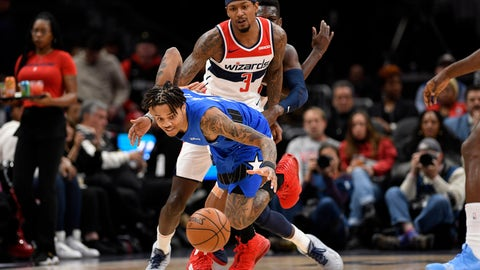 <p>               Orlando Magic guard Markelle Fultz, front, chases a loose ball in front of Washington Wizards guard Bradley Beal (3) during the first half of an NBA basketball game Wednesday, Jan. 1, 2020, in Washington. (AP Photo/Nick Wass)             </p>