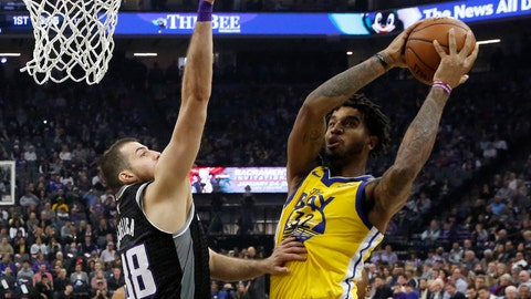 <p>               Golden State Warriors forward Marquese Chriss, right, goes to the basket against Sacramento Kings forward Nemanja Bjelica during the first quarter of an NBA basketball game in Sacramento, Calif., Monday, Jan. 6, 2020. (AP Photo/Rich Pedroncelli)             </p>