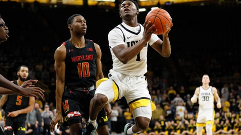 <p>               Iowa guard Joe Toussaint, center right, drives to the basket past Maryland guard Serrel Smith Jr., left, during the second half of an NCAA college basketball game, Friday, Jan. 10, 2020, in Iowa City, Iowa. (AP Photo/Charlie Neibergall)             </p>