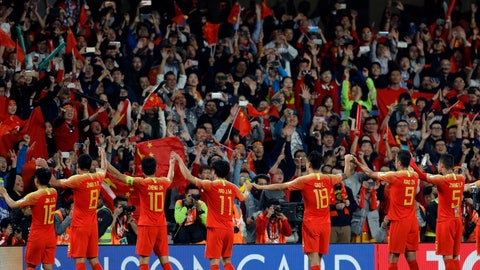 """<p>               FILE - In this Jan. 20, 2019, file photo, Chinese players greet supporters at the end of the AFC Asian Cup round of 16 soccer match between Thailand and China at the Hazza Bin Zayed stadium in Al Ain, United Arab Emirates.Barely weeks into the new decade, Chinese soccer's """"2020 Action Plan"""" is in tatters after another international tournament failure that ended with players leaving the field in tears after losing all three games without scoring a goal. China's Football Association set a number of targets for the men's national teams at various age levels to meet by this year. None have been met.  (AP Photo/Hassan Ammar, File)             </p>"""