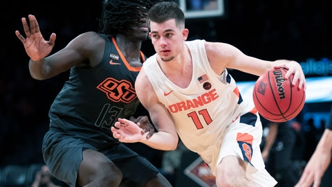 <p>               FILE - In this Wednesday, Nov. 27, 2019 file photo, Syracuse guard Joseph Girard III (11) drives against Oklahoma State guard Isaac Likekele (13) during the second half of an NCAA college semi final basketball game in the NIT Season Tip-Off tournament in New York. Freshman guard Joe Girard has become an important player for Syracuse as the Orange try to make some headway in the Atlantic Coast Conference. (AP Photo/Mary Altaffer, File)             </p>