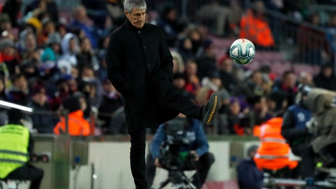 <p>               Barcelona's head coach Quique Setien kicks the ball back to the pitch during a Spanish La Liga soccer match between Barcelona and Granada at Camp Nou stadium in Barcelona, Spain, Sunday, Jan. 19, 2020. (AP Photo/Joan Monfort)             </p>
