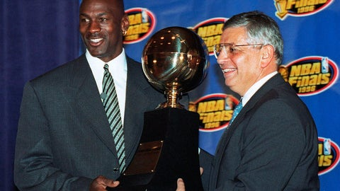 <p>               FILE - In this June 18, 1996, file photo, Chicago Bulls' Michael Jordan, left, receives the NBA Finals Most Valuable Player trophy from Commissioner David Stern during a ceremony in Chicago. David Stern, who spent 30 years as the NBA's longest-serving commissioner and oversaw its growth into a global power, has died on New Year's Day, Wednesday, Jan. 1, 2020. He was 77.  (AP Photo/Charles Bennett, File)             </p>