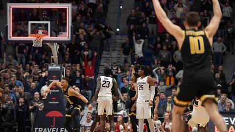 <p>               Wichita State's Dexter Dennis, left and teammate Wichita State's Erik Stevenson, far right react at the end of a double overtime an NCAA college basketball game against Connecticut, Sunday, Jan. 12, 2020, in Hartford, Conn. (AP Photo/Jessica Hill)             </p>