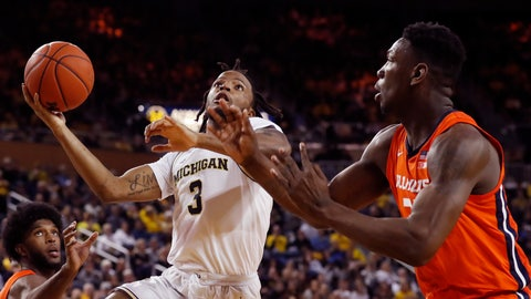 <p>               Michigan guard Zavier Simpson (3) attempts a layup as Illinois center Kofi Cockburn (21) defends during the second half of an NCAA college basketball game, Saturday, Jan. 25, 2020, in Ann Arbor, Mich. (AP Photo/Carlos Osorio)             </p>
