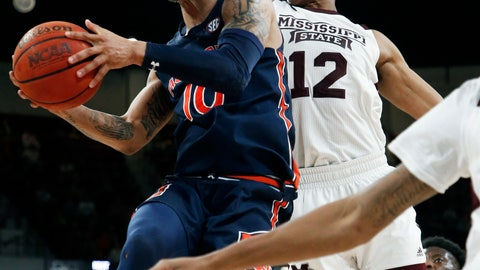 <p>               Auburn guard Samir Doughty (10) attempts a layup past Mississippi State guard Robert Woodard II (12) during the second half of an NCAA college basketball game, Saturday, Jan. 4, 2020, in Starkville, Miss. Auburn won 80-68. (AP Photo/Rogelio V. Solis)             </p>