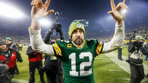 <p>               Green Bay Packers' Aaron Rodgers celebrates as he walks off the field after an NFL divisional playoff football game against the Seattle Seahawks Sunday, Jan. 12, 2020, in Green Bay, Wis. The Packers won 28-23 to advance to the NFC Championship. (AP Photo/Mike Roemer)             </p>