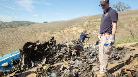 <p>               In this image taken Monday, Jan. 27, 2020, and provided by the National Transportation Safety Board, NTSB investigators Adam Huray, right, and Carol Hogan examine wreckage as part of the NTSB's investigation of a helicopter crash near Calabasas, Calif. The Sunday, Jan. 26 crash killed former NBA basketball player Kobe Bryant, his 13-year-old daughter, Gianna, and seven others (James Anderson/National Transportation Safety Board via AP)             </p>