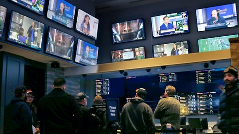 <p>               FILE - In this Nov. 18, 2019, file photo, patrons visit the sports betting area of Twin River Casino in Lincoln, R.I. Gambling regulators and sports books in several U.S. states are preparing to allow gamblers to bet on XFL games once the league's season begins in early February 2020. (AP Photo/Steven Senne, File)             </p>