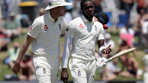 <p>               FILE- In this Nov. 24, 2019 file photo, England's Stuart Broad, left, chats with teammate Jofra Archer during play on day four of the first cricket test between England and New Zealand at Bay Oval in Mount Maunganui, New Zealand. A New Zealand fan who racially abused Archer during a test match at Bay Oval in November has been banned from domestic and international matches in New Zealand for two years. (AP Photo/Mark Baker)             </p>