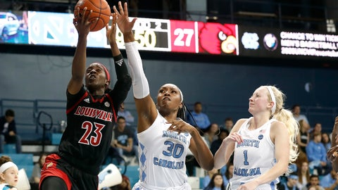 <p>               Louisville guard Jazmine Jones (23) shoots while North Carolina center Janelle Bailey (30) and guard Taylor Koenen (1) defend during the first half of an NCAA college basketball game in Chapel Hill, N.C., Sunday, Jan. 19, 2020. (AP Photo/Gerry Broome)             </p>
