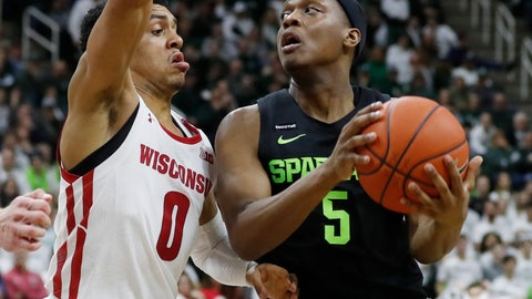 <p>               Michigan State guard Cassius Winston (5) looks to shoot as Wisconsin guard D'Mitrik Trice (0) defends during the second half of an NCAA college basketball game, Friday, Jan. 17, 2020, in East Lansing, Mich. (AP Photo/Carlos Osorio)             </p>