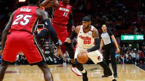 <p>               Portland Trail Blazers forward Carmelo Anthony (00) drives to the basket against Miami Heat guard Kendrick Nunn (25) and center Bam Adebayo (13) during the first half of an NBA basketball game, Sunday, Jan. 5, 2020, in Miami. (AP Photo/Wilfredo Lee)             </p>
