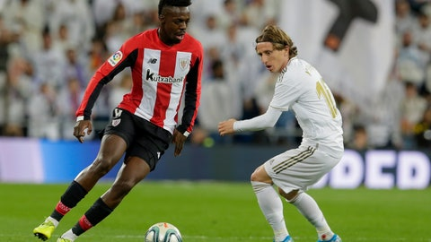 <p>               Athletic Bilbao's Inaki Williams, left, and Real Madrid's Luka Modric fight for the ball during a Spanish La Liga soccer match between Real Madrid and Athletic Bilbao at the Santiago Bernabeu stadium in Madrid, Spain, Sunday Dec. 22, 2019. (AP Photo/Paul White)             </p>
