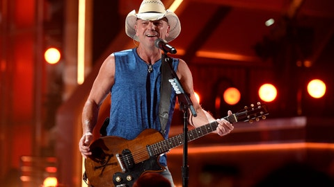 """<p>               FILE - In this April 15, 2018, file photo, Kenny Chesney performs """"Get Along"""" at the 53rd annual Academy of Country Music Awards at the MGM Grand Garden Arena on Sunday, in Las Vegas. Through his song """"Boys of Fall,"""" Kenny Chesney has a direct connection to this Super Bowl. The song has become something of an anthem for high school football, celebrating the teamwork and dedication it takes to play the sport _ really on any level. It was written by Pro Football Hall of Famer Bobby Beathard's son Casey, who has penned several hits for the country superstar. Beathard's son, C.J., is a backup quarterback for the 49ers.(Photo by Chris Pizzello/Invision/AP, File)             </p>"""