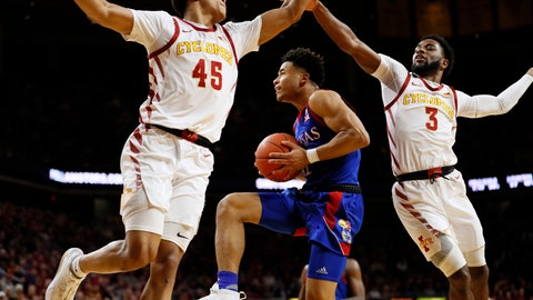 <p>               Kansas guard Devon Dotson, center, drives to the basket between Iowa State's Rasir Bolton, left, and Tre Jackson during the first half of an NCAA college basketball game Wednesday, Jan. 8, 2020, in Ames, Iowa. (AP Photo/Charlie Neibergall)             </p>
