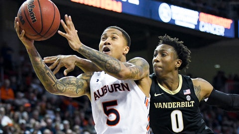 <p>               Vanderbilt guard Saben Lee (0) defends a drive to the basket by Auburn guard J'Von McCormick (5) during the second half of an NCAA college basketball game Wednesday, Jan. 8, 2020, in Auburn, Ala. (AP Photo/Julie Bennett)             </p>
