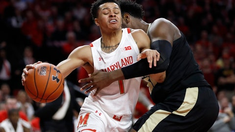 <p>               Maryland guard Anthony Cowan Jr. (1) drives against Purdue forward Trevion Williams during the first half of an NCAA college basketball game, Saturday, Jan. 18, 2020, in College Park, Md. (AP Photo/Julio Cortez)             </p>