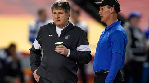 <p>               Washington State coach Mike Leach, left, and Air Force  coach Troy Calhoun talk before the Cheez-It Bowl NCAA college football bowl game, Friday, Dec. 27, 2019, in Phoenix. (AP Photo/Rick Scuteri)             </p>