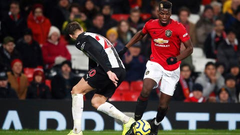 <p>               Manchester United's Paul Pogba, right, and Newcastle United's Florian Lejeune battle for the ball during their English Premier League soccer match at Old Trafford, Manchester, England, Thursday, Dec. 26, 2019. (Martin Rickett/PA via AP)             </p>